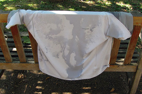 sweaty shirt hanging on a bench
