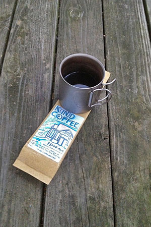 mug of brew with the Flood Mud bag.