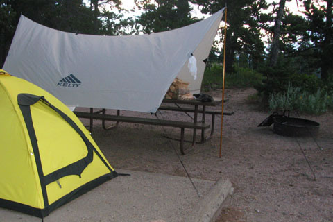 Car Tarp set up in campground