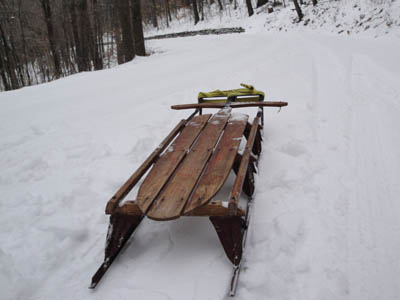 lightning guider sled on a snowy road