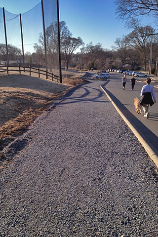 New path along the parking area of the Community Center. The path goes around the driving range