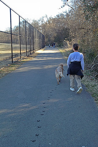 Jake and Amy walking along the greenway.