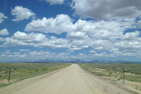 The Wind River Range in the distance from the dirt road