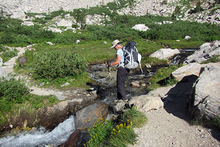 Crossing the creek to reach the Meadows camping zone