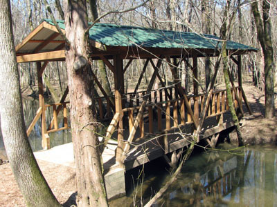 covered bridge on the trail to the public boat launch