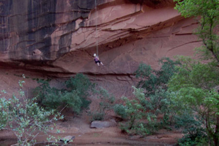 rappelling from the canyon wall